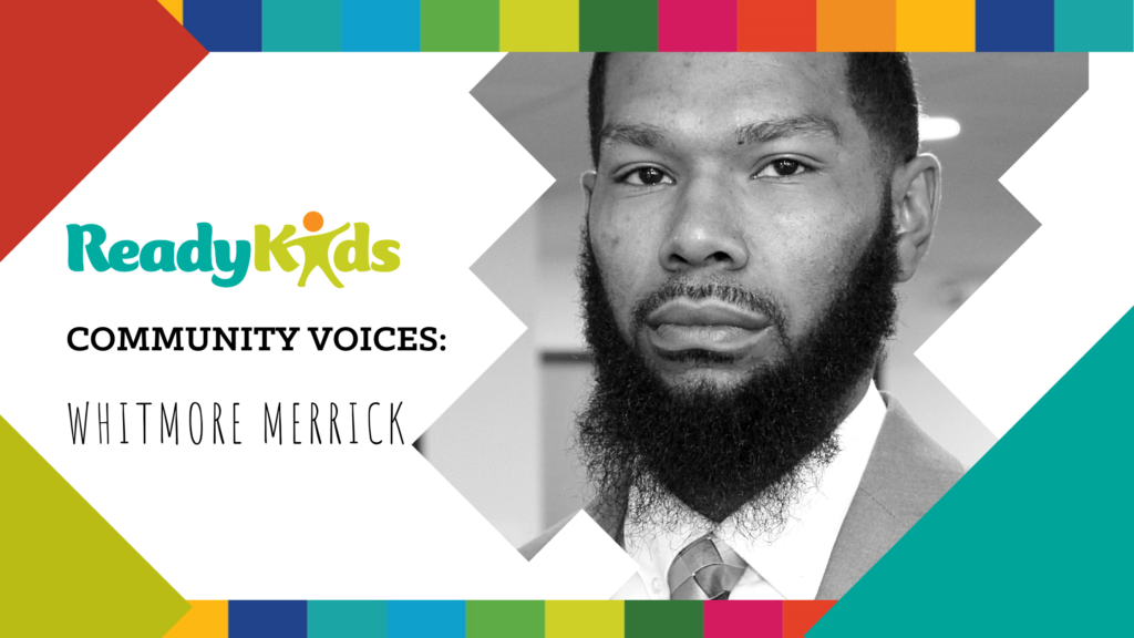 Community Voices: Whitmore Merrick, African-American man with beard in suit and tie